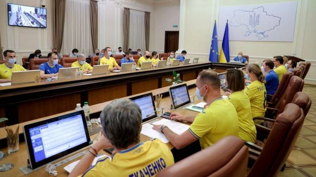 Ukrainian ministers wear the soccer national team's yellow-and-blue jerseys following Ukraine's defeat of Sweden in their Euro 2020 Round of 16 match as they attend a meeting of the government in Kyiv, Ukraine June 30, 2021